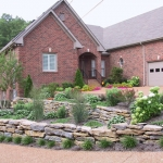 After shot of the rock garden we added in this front yard to address of the slope issue.